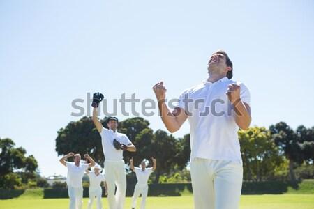 Mutlu kriket takım ayakta alan açık gökyüzü Stok fotoğraf © wavebreak_media