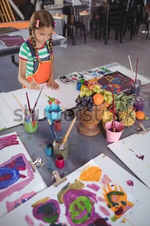 Iskolás gyerekek gyakorol rajz iskola nő lány Stock fotó © wavebreak_media