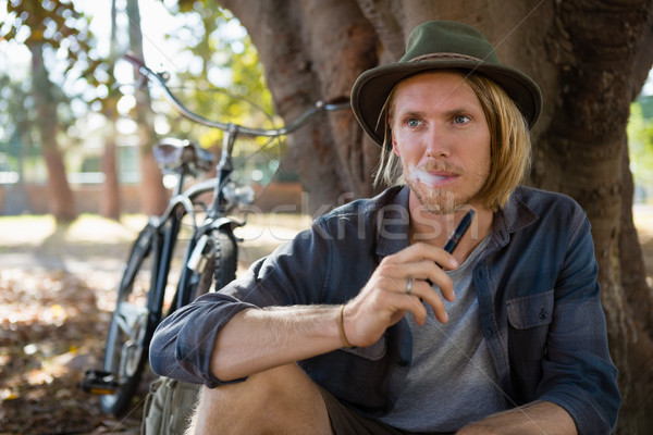 Man smoking an electronic cigarette in the park Stock photo © wavebreak_media