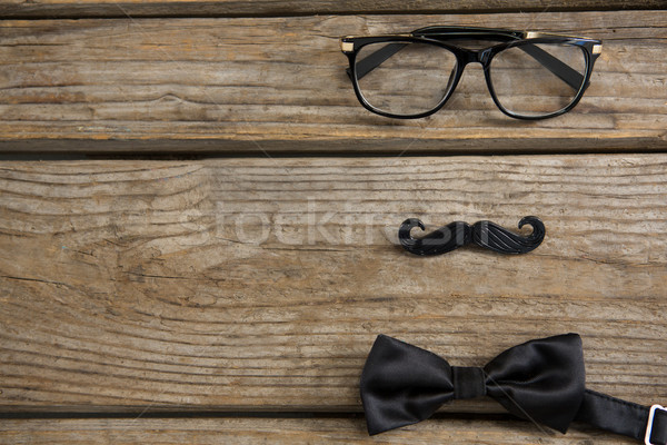 High angle view of mustache with eyeglasses and bow tie on table Stock photo © wavebreak_media