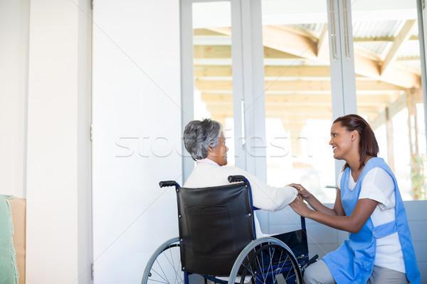 Female doctor interacting with senior woman on wheelchair Stock photo © wavebreak_media