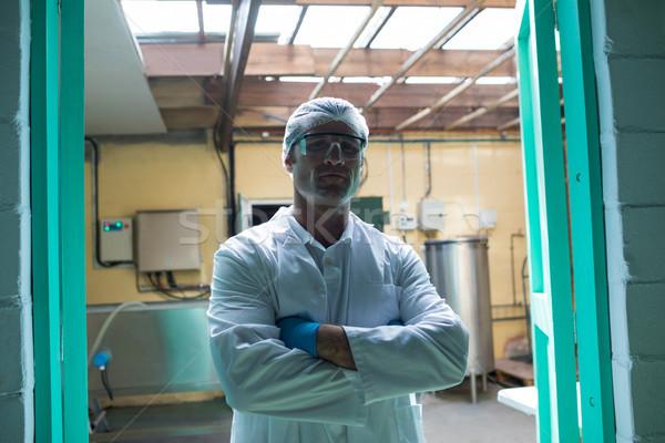 Portrait of scientist with arms crossed standing at doorway Stock photo © wavebreak_media