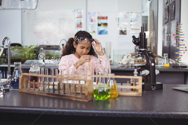 Elementary student holding test tube at laboratory Stock photo © wavebreak_media