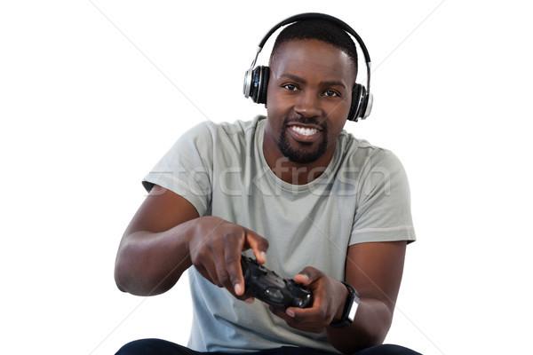 Сток-фото: улыбаясь · человека · играет · видеоигра · белый · портрет