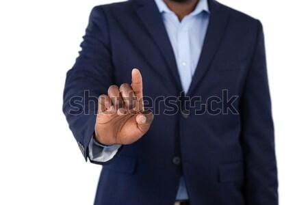 üzletember kisajtolás láthatatlan virtuális képernyő középső rész Stock fotó © wavebreak_media