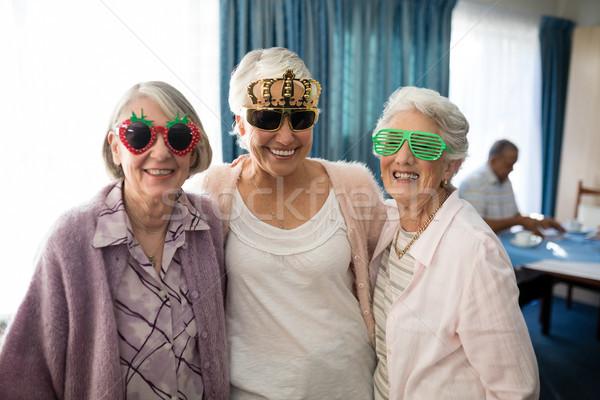 Smiling senior women wearing novelty glasses Stock photo © wavebreak_media