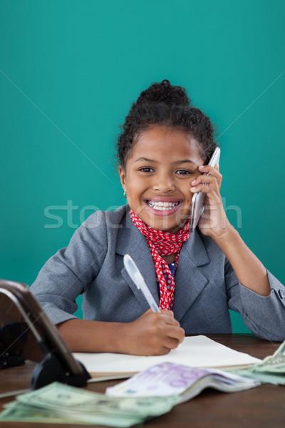Smiling businesswoman talking on mobile phone Stock photo © wavebreak_media