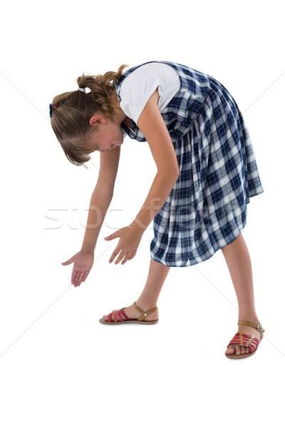 Lány tart láthatatlan tárgy fehér gyermek Stock fotó © wavebreak_media