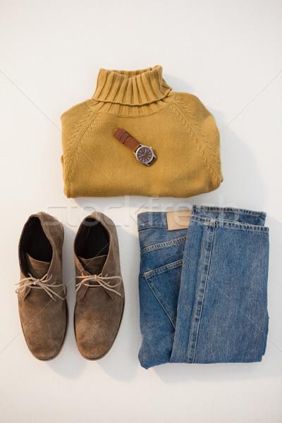 Pary buty sweter dżinsy oglądać biały Zdjęcia stock © wavebreak_media
