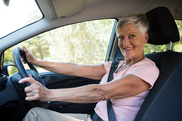 Ativo senior mulher condução carro retrato Foto stock © wavebreak_media