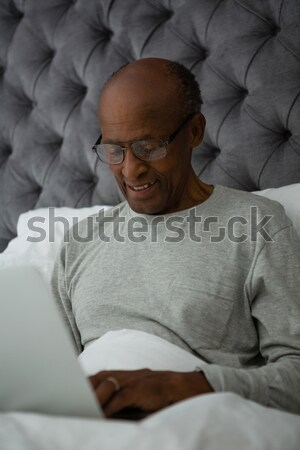 High angle view of sick young woman sleeping on bed Stock photo © wavebreak_media
