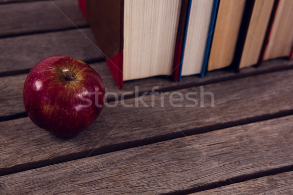 Close-up of apple and books arranged on wooden table Stock photo © wavebreak_media