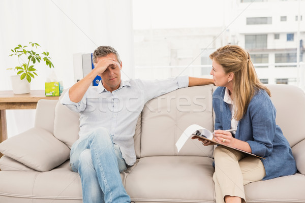 Concerned therapist talking with male patient Stock photo © wavebreak_media