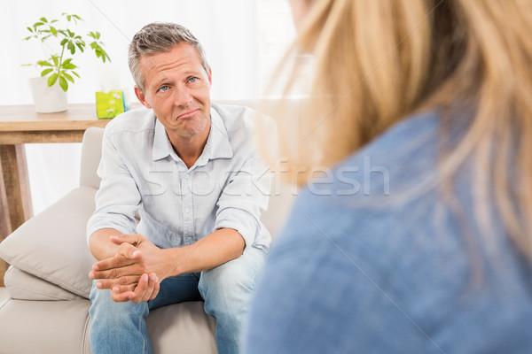 Preocupado homem sessão sofá falante terapeuta Foto stock © wavebreak_media