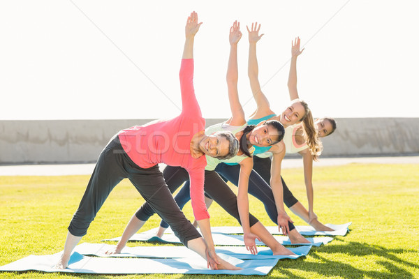 Sonriendo deportivo mujeres triángulo plantean yoga Foto stock © wavebreak_media