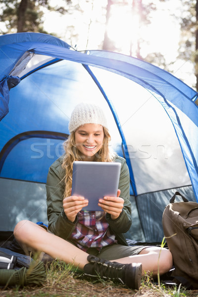 Pretty blonde camper using tablet and sitting in tent Stock photo © wavebreak_media