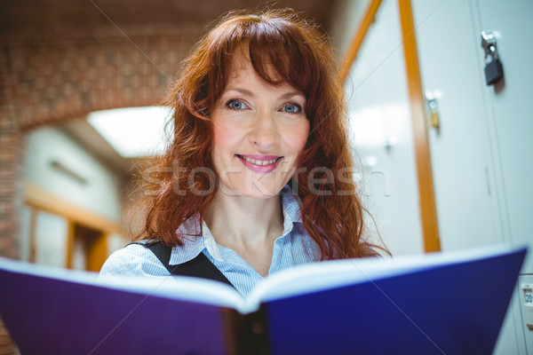 Mature student smiling at camera in hallway Stock photo © wavebreak_media