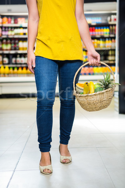 Cropped image of woman holding basket  Stock photo © wavebreak_media