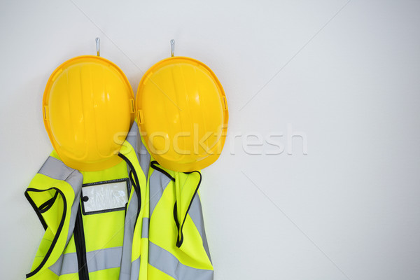Close-up of protective workwear hanging on hook Stock photo © wavebreak_media