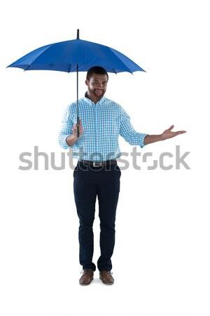 Homme exécutif permanent parapluie blanche affaires Photo stock © wavebreak_media