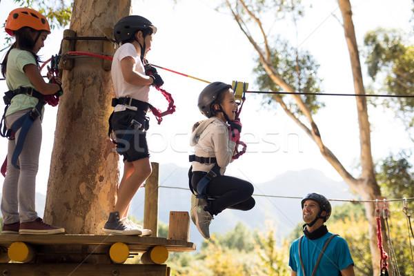 Kids enjoying zip line adventure on sunny day Stock photo © wavebreak_media