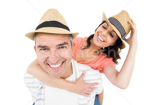 Handsome man piggy backing his wife Stock photo © wavebreak_media