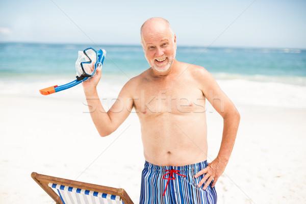 Senior man standing next to sunchair Stock photo © wavebreak_media
