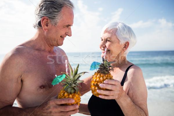Casal de idosos ananás coquetel praia Foto stock © wavebreak_media