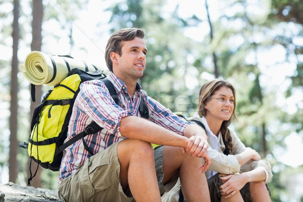 Low angle view of couple sitting on rock while hiking  Stock photo © wavebreak_media