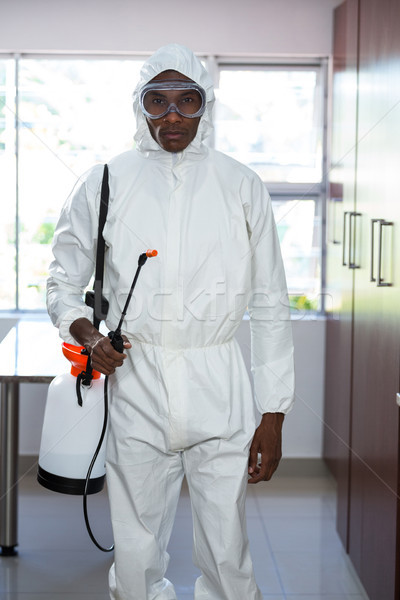 Portrait of pest control man standing with insecticide sprayer Stock photo © wavebreak_media