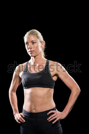 Female athlete standing with hand on hip Stock photo © wavebreak_media