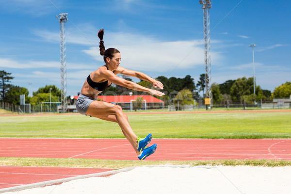 Female athlete performing a long jump Stock photo © wavebreak_media