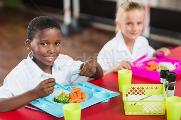 Fiú lány iskola egyenruhák ebéd büfé Stock fotó © wavebreak_media