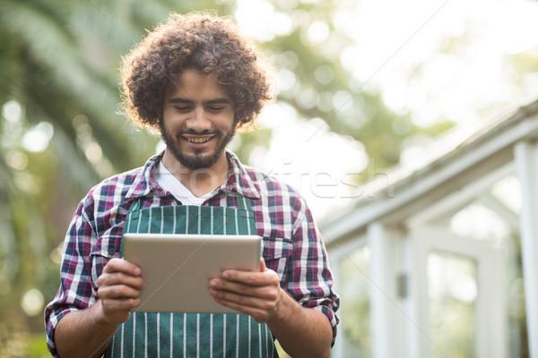 male gardener using tablet computer at greenhouse Stock photo © wavebreak_media