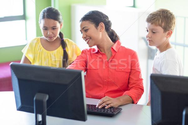 Teacher with children in computer class Stock photo © wavebreak_media