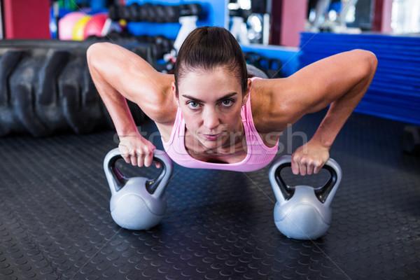 Portret kobiet sportowiec pompek siłowni kobieta Zdjęcia stock © wavebreak_media