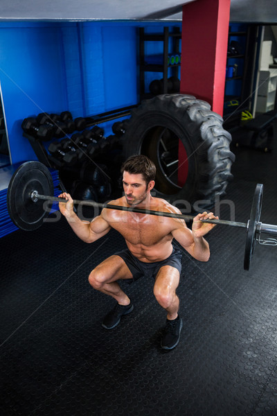 Torse nu homme barbell gymnase Photo stock © wavebreak_media