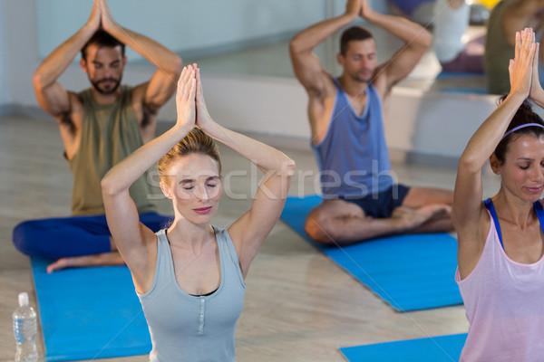 Group of people performing yoga Stock photo © wavebreak_media
