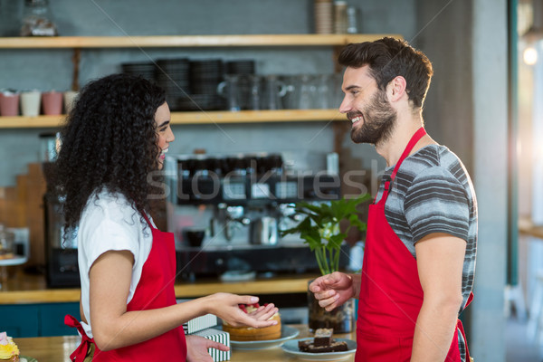 Waiter and waitress interacting with each other in café Stock photo © wavebreak_media