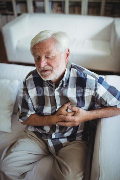 Altos hombre sufrimiento pecho dolor casa Foto stock © wavebreak_media