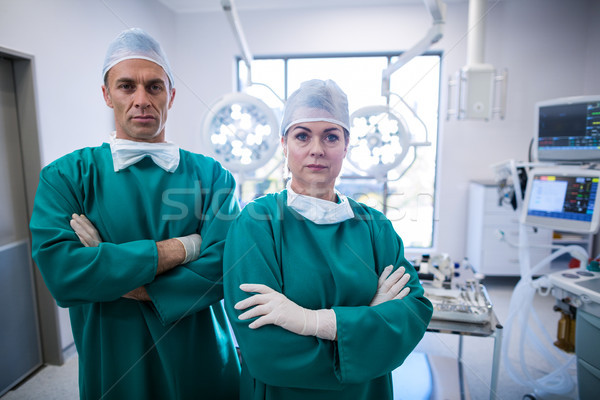 Portrait of surgeons standing with arms crossed in operation room Stock photo © wavebreak_media