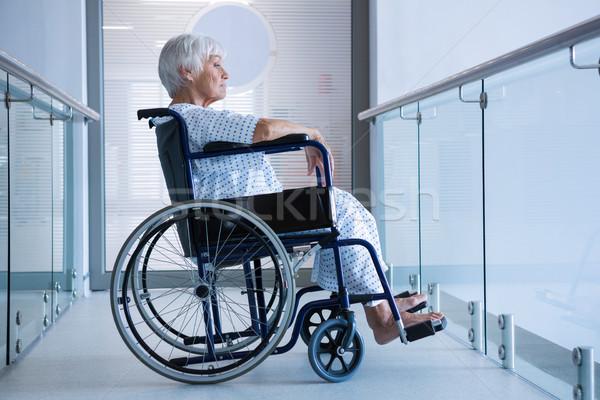 Disabled senior patient on wheelchair in hospital passageway Stock photo © wavebreak_media