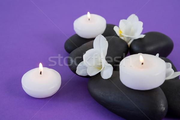 Fiori bianchi candele zen pietra viola fiore Foto d'archivio © wavebreak_media