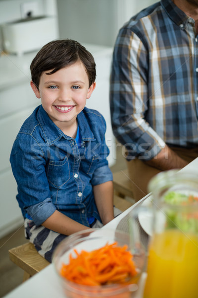 Portret glimlachend jongen vergadering eettafel home Stockfoto © wavebreak_media