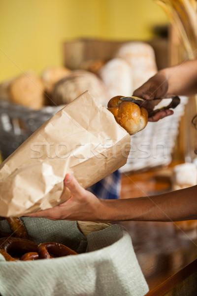 Staff packing bread in paper bag at bakery shop Stock photo © wavebreak_media