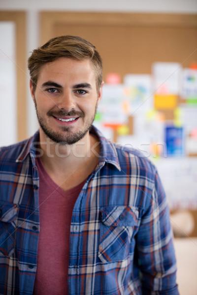 Smiling man in office Stock photo © wavebreak_media