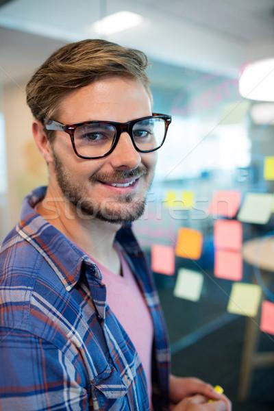 Adam ofis ayakta duvar gülen Stok fotoğraf © wavebreak_media