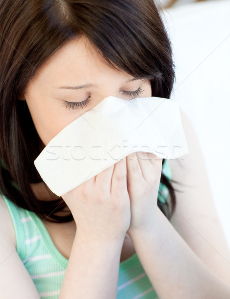 Portrait of a sick tired teen girl blowing Stock photo © wavebreak_media