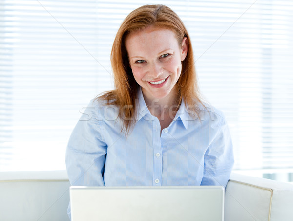 Self-assured business woman working on a laptop computer Stock photo © wavebreak_media