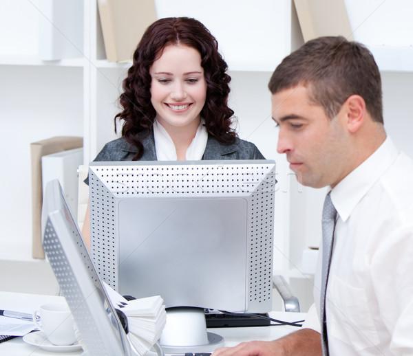Fiatal üzletemberek dolgozik számítógépek iroda számítógép Stock fotó © wavebreak_media